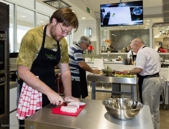 Men attending cooking class