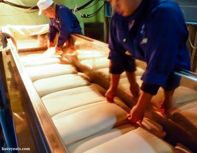 Pressing of sake mash (Urakasumi Sake Brewery)