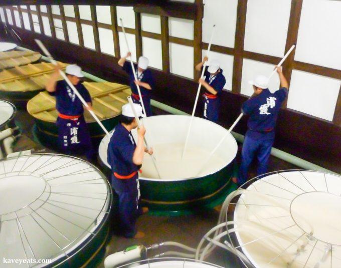 Mixing of fermentation mash for sake (Urakasumi Sake Brewery)