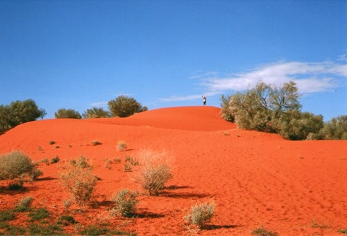 Red Nomad OZ on Red Sand Dune Outback Queensland Australia