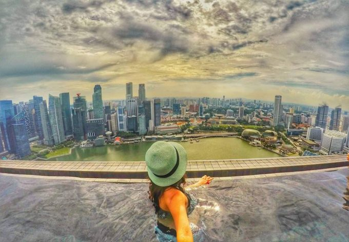 Traveller in high rise pool looking out over Singapore - 100 Fantastic Cities for City Breaks, as chosen by travel bloggers (part 5)