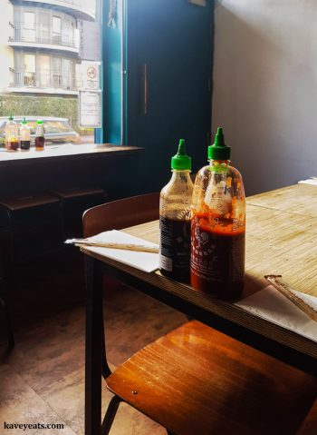 Dalston restaurant Salvation in Noodle, serving Vietnamese food, on the table Sriracha and Hoisin sauces