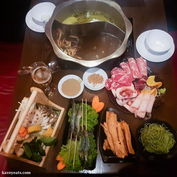 Twin Broth Hot Pot and Ingredients from Overhead at Hot Pot Restaurant China Town London on Kavey Eats