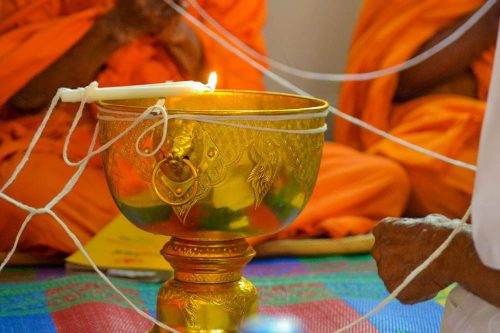 Buddhist Monk Blessed Sai Sin Sacred Threads - The best souvenirs to buy in Thailand