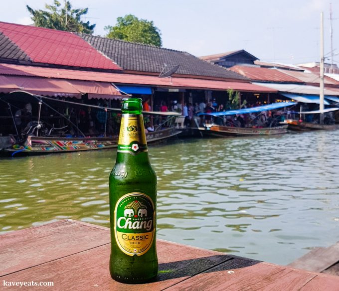 Enjoying a bottle of Chang Beer at one of Bangkok's Floating Markets, in Thailand