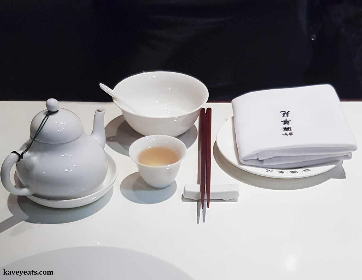Table setting with bowl, plate, napkin, chopsticks, tea pot and tea cup at Xu London