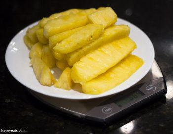 Weighing fresh pineapple to make a pineapple jam filling