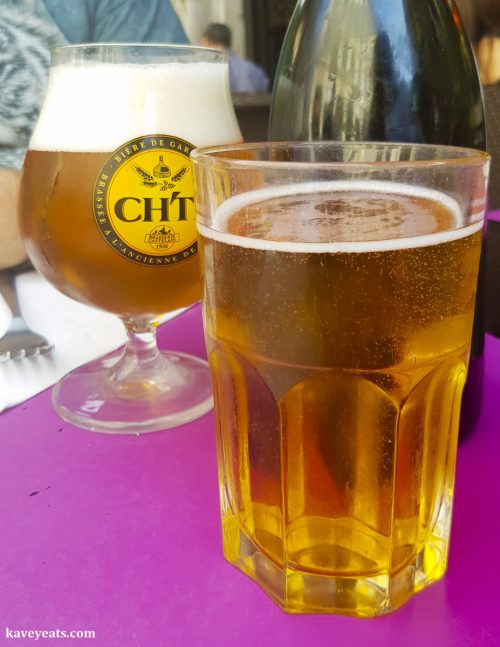 Glasses of cider and beer at La Crêperie de la Vieille Bourse Restaurant in Lille