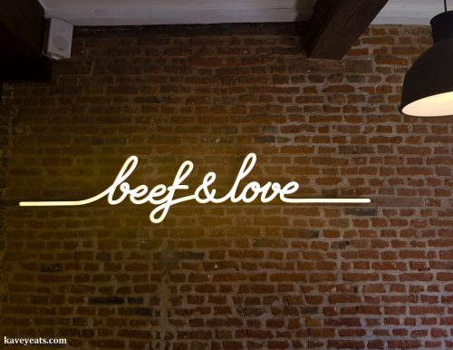 Beef and love neon sign at Burgers Le Comptoir Volant Burger Restaurant in Lille