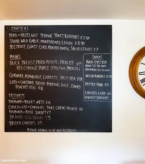 Daily menu on blackboard at The Black Bear Inn, a gastropub