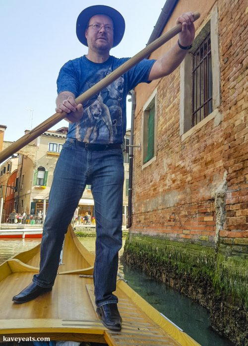 Tourist rowing along Venice canal during a lesson with Row Venice