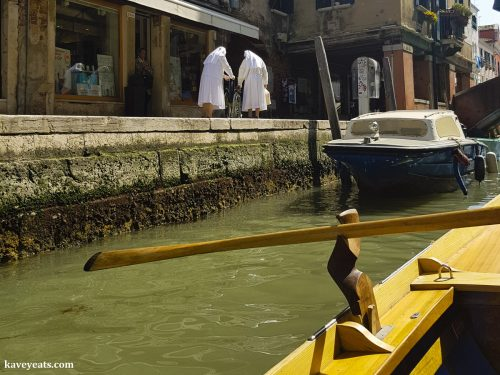 View of two nuns taken from a rowboat on the Venetian canal