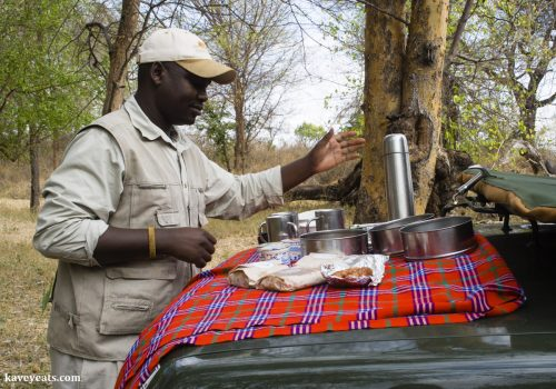 Maasai blanket used for a car bonnet picnic