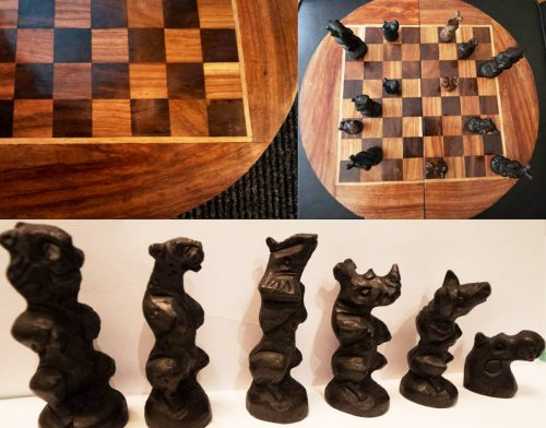 Wooden carved chessboard featuring wild animals