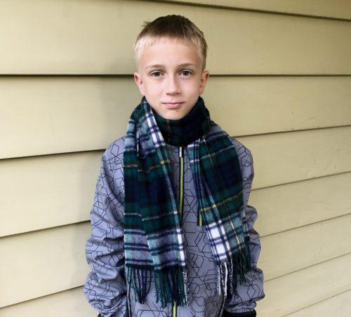 Boy wearing tartan scarf