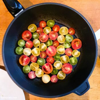 Placing tomatoes into pan for Tomato Tarte Tatin