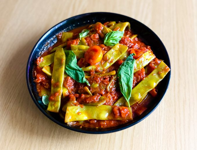Slow-cooked flat beans with tomato, pancetta and chilli