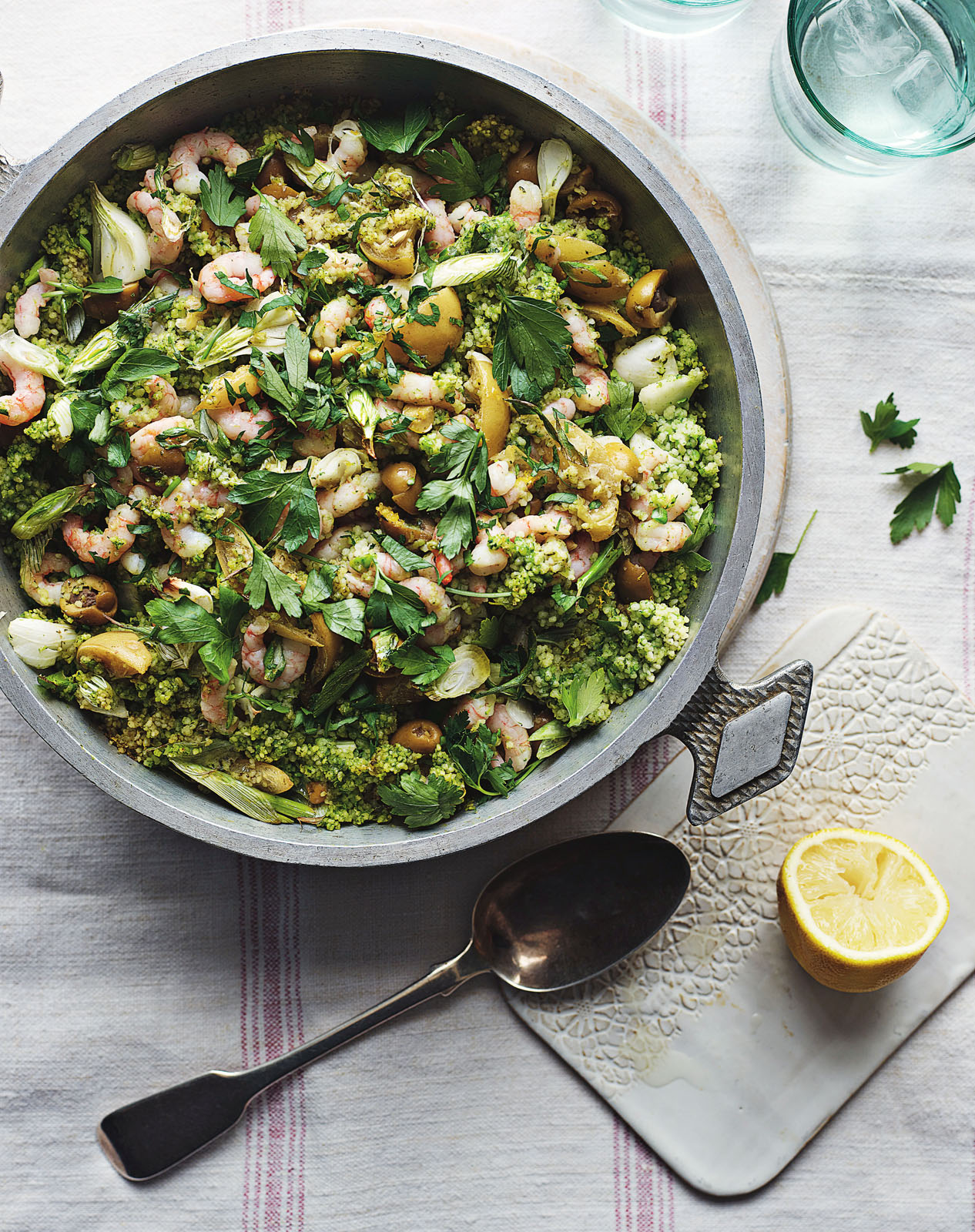 Green couscous with prawns recipe from Roasting Pan Suppers by Rosie Sykes