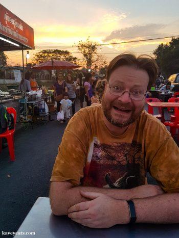 Hungry diner at a table in Bang Lan Night Market in Ayutthaya Thailand