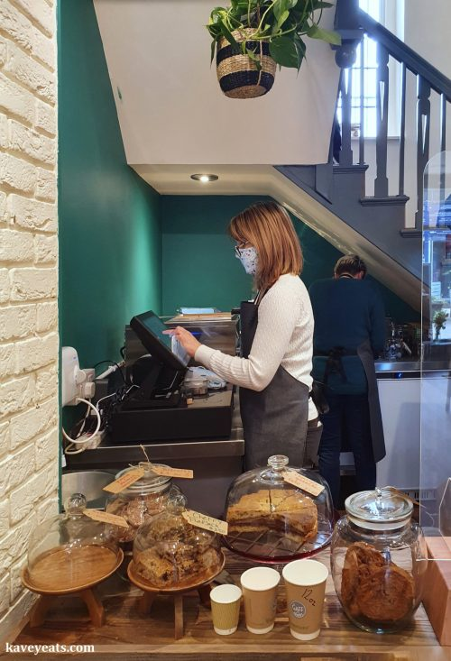 Staff serving in a cafe at the counter