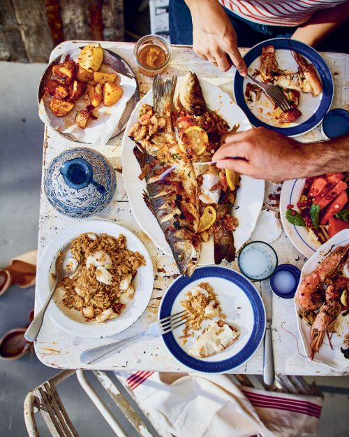 Grilled fish and side dishes on a table