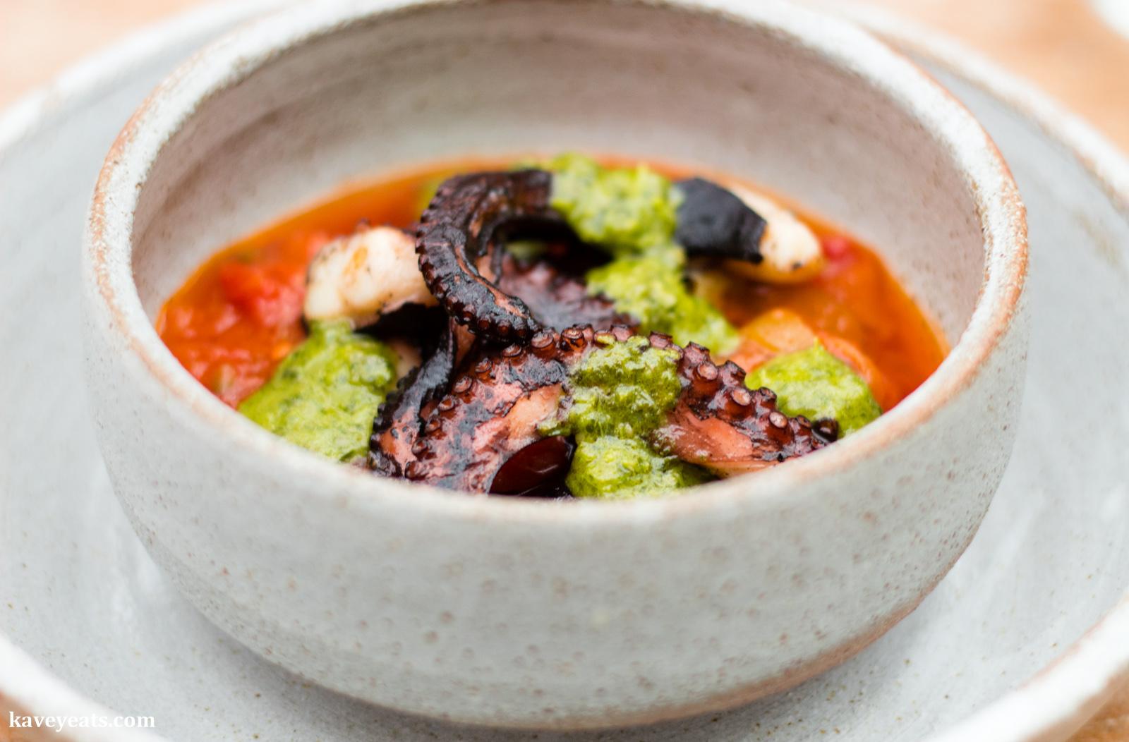 Roast octopus, red pepper, tomato, green sauce