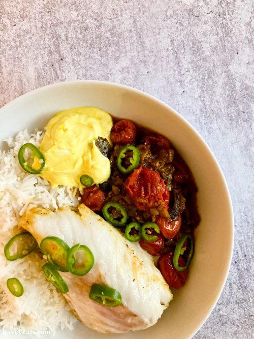 Slow cooked tomatoes, baked code, turmeric yoghurt