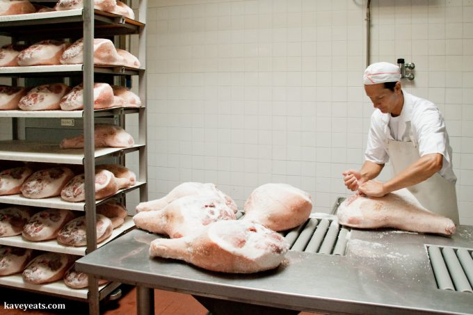 Parma ham legs being salted